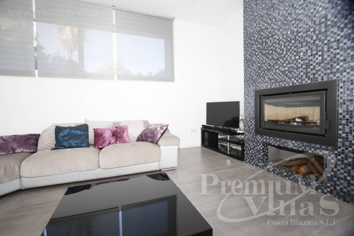 Living room with fireplace in the modern villa near the beach in Calpe - C2130 - Modern villa for sale next to the town Calpe 17